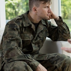 Despair young military man during psychological therapy
