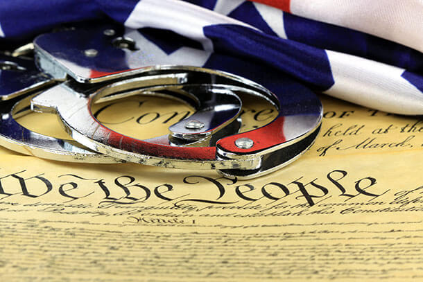 bigstock-handcuffs-and-flag-on-us-const-55849766